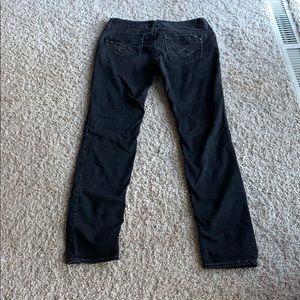 Black low rise, slim cut jeans